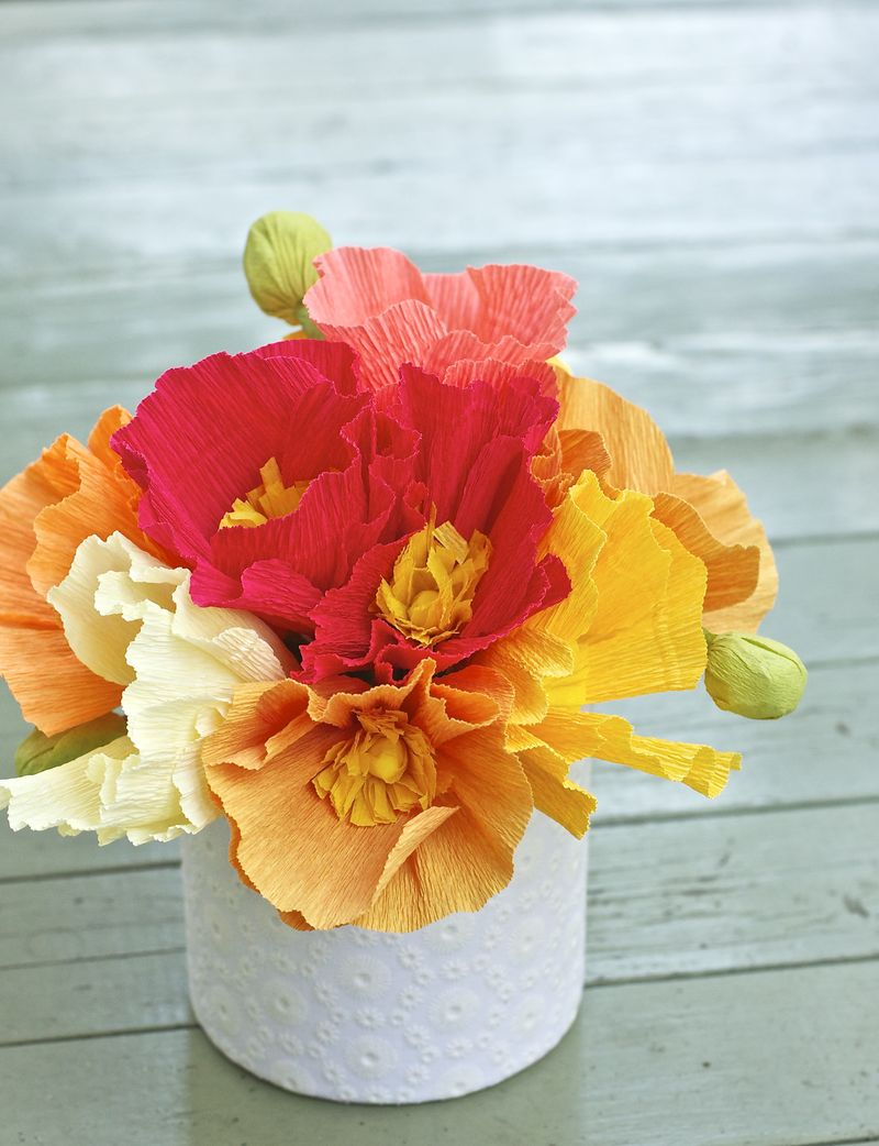 Crepe paper poppies in lace decoupaged container